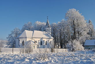 Brebu Nou - Rear view of the Catholic church from Brebu Nou in the winter of 2010