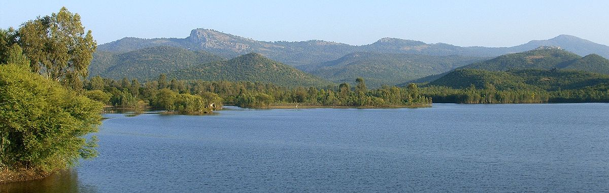 The Biligirirangan hills range is a North-South range, seen here across the Krishnayyana Katte reservoir at the foothills near the town of Yelandur. The whitish outcrop in the centre jutting out probably gives the name biligiri in Kannada to the ranges.