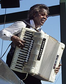 Buckwheat Zydeco playing on the main stage at the 2006 Festival International de Louisiane.