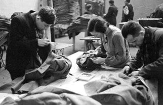 Łódź Ghetto - Jews clean and repair coats salvaged at Chełmno for redistribution among Volksdeutsche in accordance with the top secret August Frank memorandum. The Yellow badge was removed.