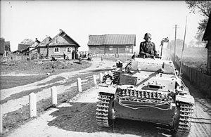 Panzer II - A Panzer II during Operation Barbarossa in 1941 moves along a road outside a village.
