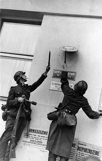 Propaganda in Nazi Germany - Wehrmacht soldiers dismantling Polish government insignia in Gdingen soon after the invasion of Poland in 1939.