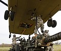 CH-47F Chinook helicopter lifting M119 105mm towed howitzer.jpg