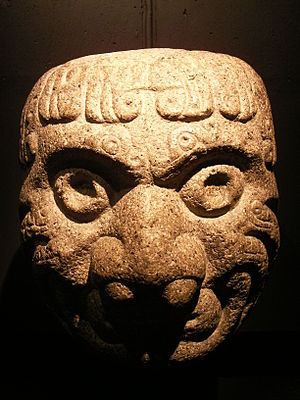 A Chavin stone art in the shape of a head.