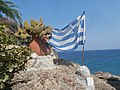 Cactaceae and Hellenic Flag at Cave Archangel Michael Panormitis Rhodes 6 September 2019.jpg