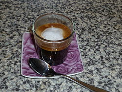 A typical espresso with milk and foam (Italy)