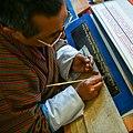 Calligrapher writing Gold Kangyur.jpg