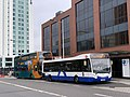Cardiff Bus 307 CN65 AAV & New Adventure Travel YJ15 AOM (48814608997).jpg