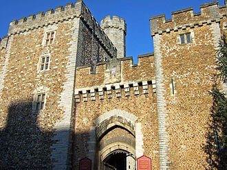 Cardiff Castle - The South Gate, showing the restored 15th century Black Tower (l) and the barbican tower (r)