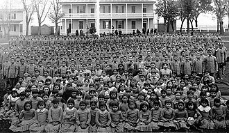 Cultural assimilation of Native Americans - Pupils at Carlisle Indian Industrial School, Pennsylvania (c. 1900)