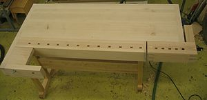 """Workbench - European style woodworking workbench  In most instances the """"end caps"""" and the """"shoulder vise arm"""" are significantly thicker than is shown, above. Indeed, this shoulder vise and its """"arm"""" appears to be incomplete."""