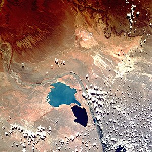 Cerros Colorados Complex - Cerros Colorados Complex, photographed from the Space Shuttle. Los Barreales is the lighter blue lake on top; Mari Menuco is the smaller and darker one. The river flows from the top-left, turns to the right of the lakes and then down.