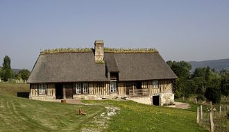 Architecture of Normandy - Vernacular half-timbered thatched cottage in Lieuvin