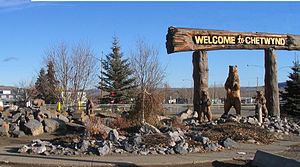 Chetwynd, British Columbia - Sign and chainsaw carvings along Highway 97 welcoming travelers going east