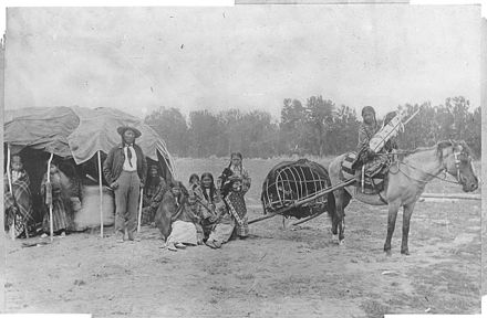 Stump Horn and his family (Cheyenne) with a horse and travois, c. 1871-1907 Cheyenne, Stump Horn and family showing Horse Travois (see Bull.77, pl 14). - NARA - 523855.jpg