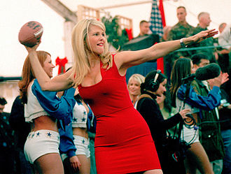 Christie Brinkley - Brinkley winds up to throw an autographed football into the audience during a USO show in the Eagle Sports Complex at Tuzla Air Base, Bosnia and Herzegovina (December 22, 1999)