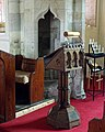 Church of the Holy Cross Great Ponton Lincolnshire England - lectern and rood screen portal.jpg