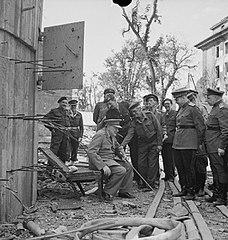 Churchill sits on bunker-chair.jpg