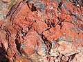 Clinker (Wasatch Formation, Lower Eocene; coal fire metamorphism at 19 ka, Late Pleistocene; large block at Interstate 90 west-bound hilltop rest area, east of Buffalo, Powder River Basin, Wyoming, USA) 5 (20122489592).jpg