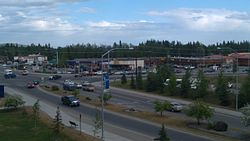 The intersection of Alumni Drive/College Road with Farmers Loop Road/University Avenue is the historic and commercial center of the College community.  Photo taken June 2011 from the side of Troth Yeddha' (College Hill), upon which the University of Alaska Fairbanks campus sits.