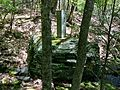 Connecticut-Massachusetts state line boundary marker in Sages Ravine near Connecticut Route 41 and Mount Riga State Park.jpg
