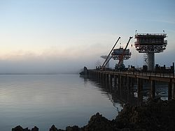 Construction of Afghanistan-Tajikistan Bridge during a foggy day.jpg