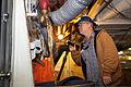 Contractor Earl Lozano drains a fire main system aboard the aircraft carrier USS Dwight D. Eisenhower (CVN 69) in Norfolk, Va., Jan. 14, 2014 140114-N-RC063-015.jpg