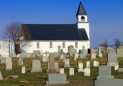 a church and cemetery in the township