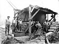 Crew posing with donkey engine, Westport Lumber Company, Westport, ca 1920's (KINSEY 2642).jpg