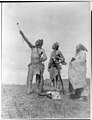 Crow Indians offering food -Edward S. Curtis.jpg