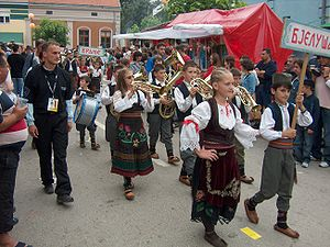 Serbian traditional clothing - A brass band from Bjeluša in folk costumes during Guca trumpet festival.