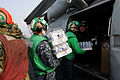 Defense.gov News Photo 110314-N-NB544-034 - Sailors assigned to Anti-Submarine Squadron 4 load supplies onto an HH-60H Sea Hawk helicopter aboard the aircraft carrier USS Ronald Reagan CVN 76.jpg