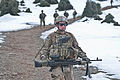 Defense.gov News Photo 120302-A-NQ379-932 - U.S. Army Pfc. Cristian Franco assigned to 3rd Battalion 509th Infantry Regiment carries an M240B machine gun while descending a mountain path.jpg