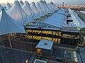 Denver International Airport Main Terminal at dusk 1.jpg