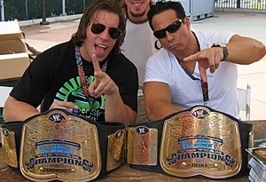 Deuce (wrestler) - Deuce (right) with Domino as the WWE Tag Team Champions