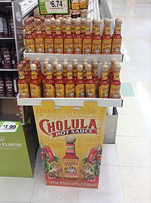 Different sorts of Cholula hot sauce in a supermarket.jpg