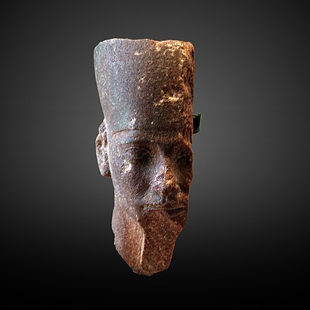 Red granite head of Djedefre, Musee du Louvre. Djedefra wearing the crown of Lower Egypt-E 11167-IMG 9702-gradient.jpg