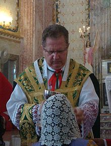 Dom Rifan distributing Holy Communion.jpg