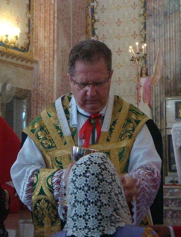 Dom Rifan distributing Holy Communion