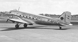 """Aigle Azur - An Aigle Azur Douglas DC-3 arriving Manchester (Ringway) Airport on 3 April 1953. It is fitted with a ventral Turbomeca Palas booster jet for use in """"hot and high operations""""."""