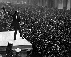 Liberty bond - Douglas Fairbanks, movie star, speaking to a large crowd in front of the Sub-Treasury building, New York City, to aid the third Liberty Loan, in April 1918