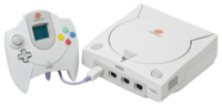An NTSC Sega Dreamcast Console and controller with VMU.