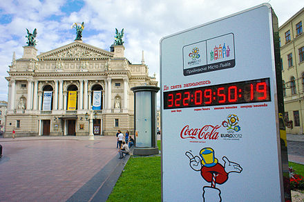 Clock in Lviv on Prospekt Svobody (Freedom Ave.), showing time to start of EURO 2012. Opera and Ballet Theatre in background EURO 2012 Lvov clock.jpg