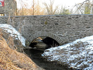 Bridge in East Fallowfield Township (Mortonville, Pennsylvania) - Mill Race Bridge, with ruins of mill in background.