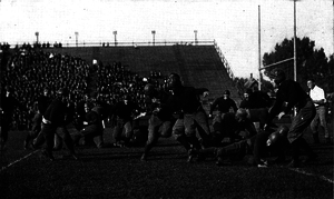Eddie Usher - Usher cutting across end for a touchdown against Tulane, 1920.