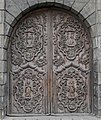 Elaborated carved wood door (17292182002).jpg