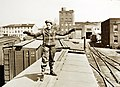 Elizabeth McDevitt, employed as a brakeman, signaling train crew members, U.S. embarkation port, WWII (34756902465).jpg