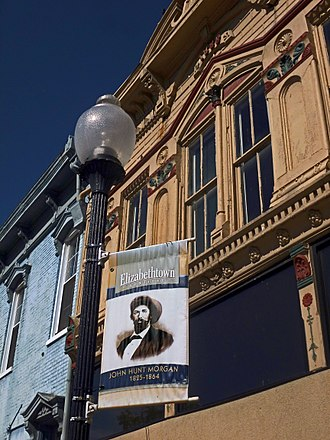Elizabethtown, Kentucky - A banner remembers John Hunt Morgan's role in the history of Elizabethtown, KY. A Confederate cannonball is imbedded in the blue building at left (the ball is visible just below and to the left of the nearest second-story window).