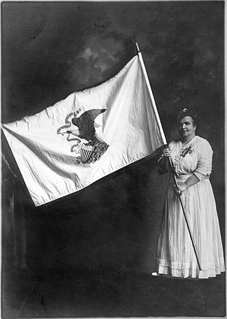 Flag and seal of Illinois - Ella Park Lawrence holds the original Illinois state flag, ca. 1915.