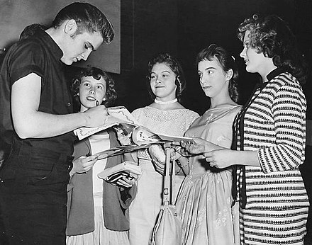Presley signing autographs in Minneapolis in 1956 Elvis signs autographs in Minneapolis 1956.jpg